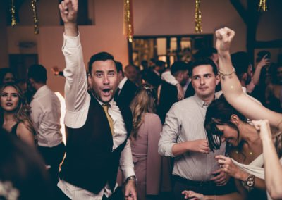 Kent wedding band winters barns punching the air
