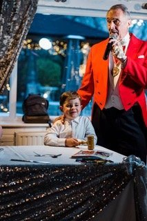 toastmaster John Oakley at wedding with young man