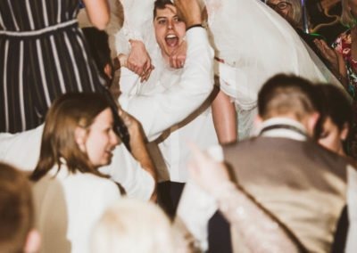 Bride lifted high on shoulders at kent wedding