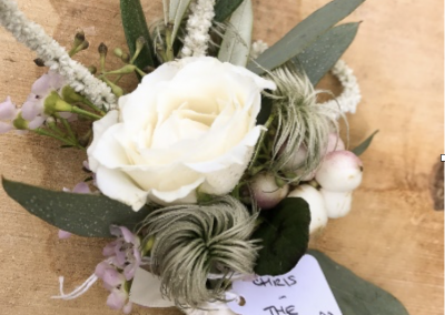 white rose groom button hole