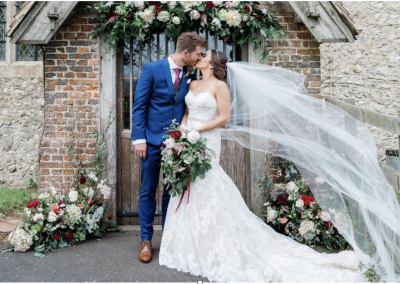 bride and groom kissing with flower surround